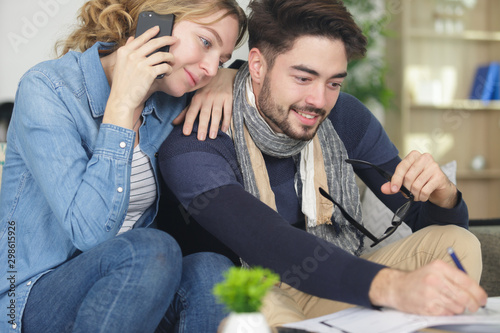 young couple filling out a form Canvas-taulu