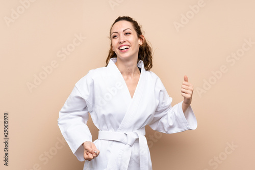 Young woman doing karate over isolated background Canvas Print