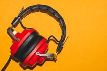 Vintage Red Headphones On Yell...