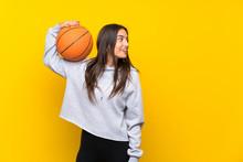 Young Woman Playing Basketball...