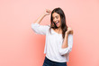 Leinwanddruck Bild - Young woman over isolated pink background celebrating a victory