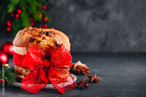 Traditional Christmas Panettone cake with dried fruits decorated with a red ribb Wallpaper Mural