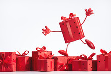 Present. A Lot Of Red Boxes With Surprises. Running Box On Legs With Hands.