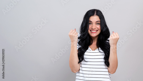 Fotografia  Successful young woman on a gray background