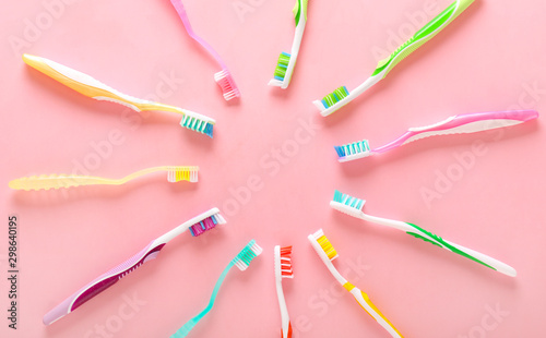 Valokuvatapetti Many tooth brushes on color background