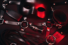 Female Set Of Sex Toys From A Sex Shop For BDSM Sex. Mask, Leather Belt, Choker, Handcuffs, Whip And Anal Plug