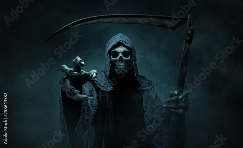 Fototapeta Grim reaper reaching towards the camera over dark, misty background with copy sp