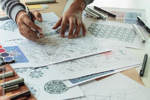 Designer designing drawing sketch pattern geometric flower seamless wallpaper fabric textile fashion industry Fototapeta