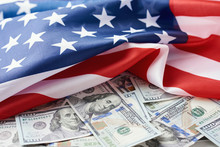 USA National Flag And The Dollar Bills. Business And Finance Concept