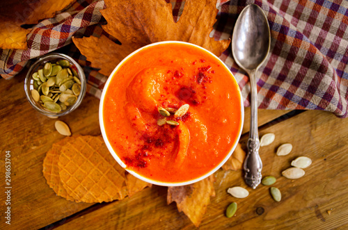Appetizing orange pumpkin cream soup. Lunch for Halloween. Canvas Print