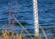 River And Lake Water Level Marker Scale Seen Partially Submerged With A Normal Water Level. Used For Monitoring Conditions In A Conservation Area.
