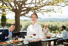 Waitress Welcoming On Restaurant Terrace