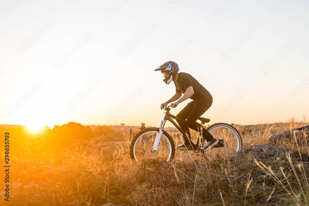 Fototapety, obrazy: Extreme mountain biking at beautiful sunset, downhill.