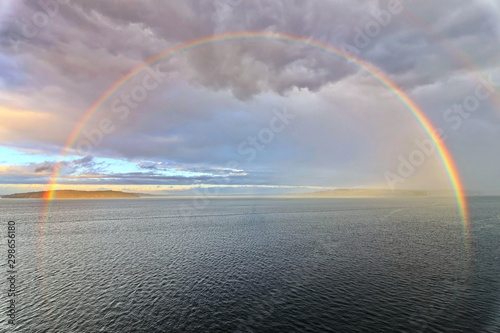 Poster Taupe Colorful views of the rainbow against the sky, clouds and sea horizon. Commencement Bay,Tacoma,USA A.