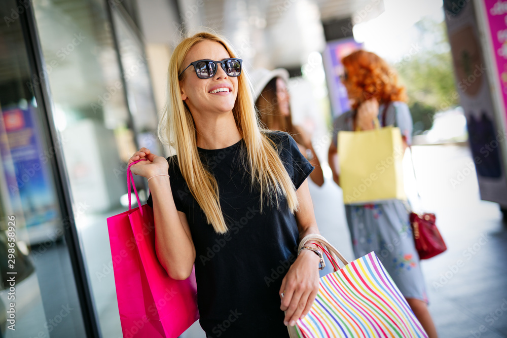 Fototapety, obrazy: Shopping, fun and tourism concept. Beautiful girls with shopping bags in ctiy
