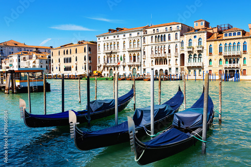 Panorama of Grand canal with boats and gondolas on sunny summer day in Venice. Italy