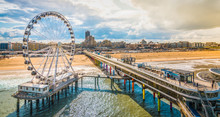 Scheveningen, The Hague, The Netherlands. Ferris Wheel And Pier At The Beach.