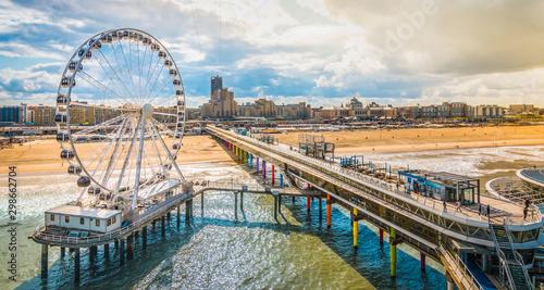Fototapeta Scheveningen, The Hague, The Netherlands. Ferris wheel and pier at the beach. obraz