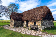 Leanach Cottage Is Shown Preserved On The Colluden Battlefield Near Inverness, Scotland. The Stone Foundation And Thatched Roof Structure Was Likely Built In The 1700s And Used During Battle In 1746.