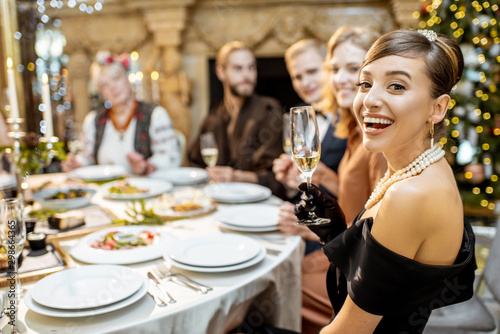 Woman with friends during a festive dinner on New Years Eve Canvas Print