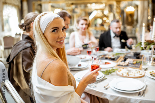 Elegant people having festive dinner at the restaurant - 298666913