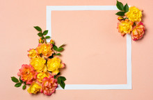 Yellow And Orange Roses Arrangement On Pastel Background