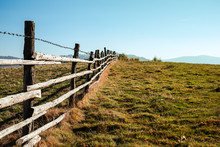 Old Wooden Fence With Barbed W...