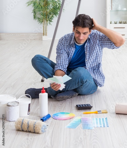 The young man overspending his budget in refurbishment project - 298672595
