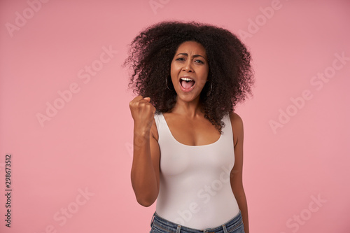Fotografija  Happy young dark skinned lady casual with curly hairstyle wearing casual clothes