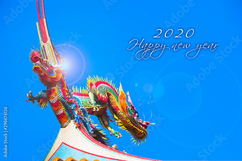 Fényképezés  New Year greeting card, inlaid craft dragon on the temple roof as background(Tex