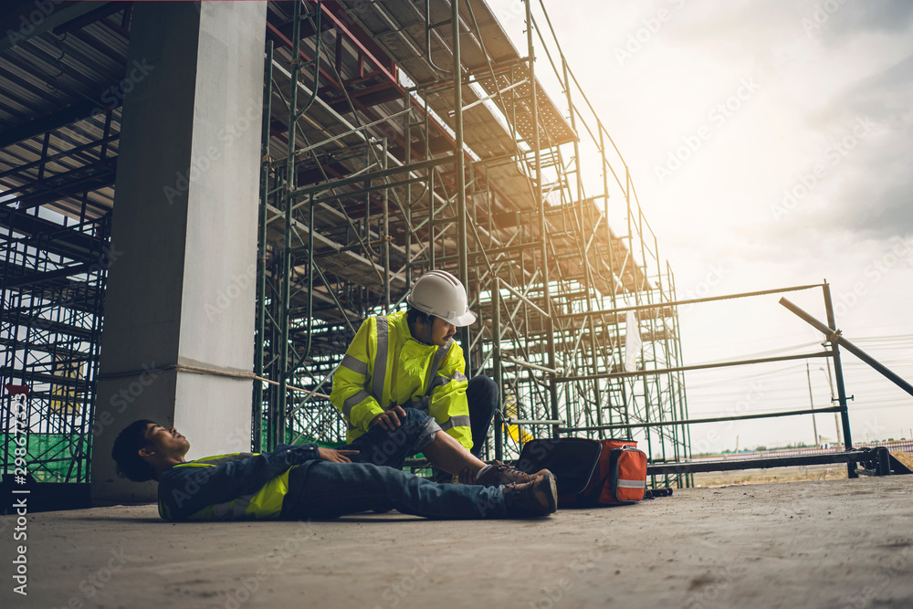 Fototapety, obrazy: First aid support accident in site work, Builder accident fall scaffolding to the floor, Safety team help employee accident.