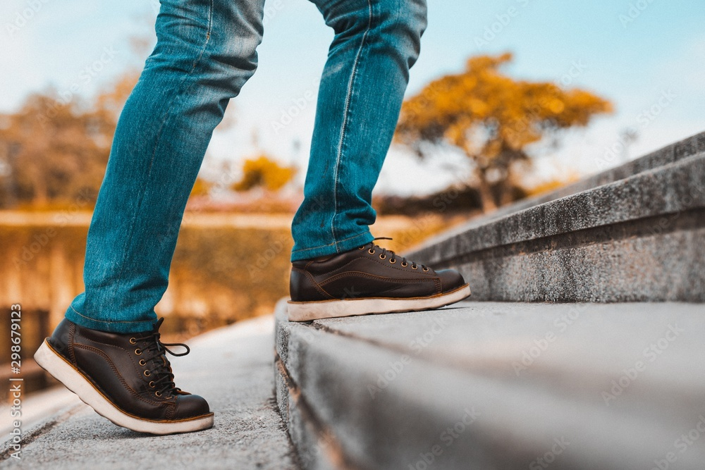 Fototapety, obrazy: Image of a man walking up the stairs.