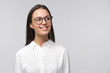 Leinwanddruck Bild - Portrait of young lady dressed in white shirt and wearing glasses looking to right side, copyspace