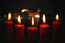 Five Red Christmas Candles With Blurred Lights