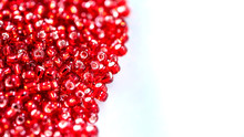 Close Up Colorful Red Glass Beads. Texture Of Beaded Necklace Or A String Of Beads For Women