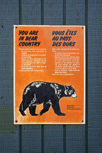 Bear Country Warning Sign In Jasper Natinal Park Canada With Black Bear In Orange