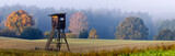 Fototapeta Na ścianę - Hunting tower on the edge of the forest during a beautiful sunrise on a foggy morning