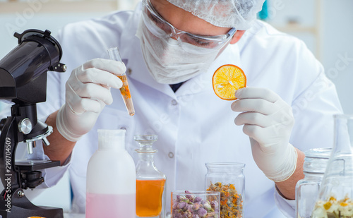 Fototapeta Chemist mixing perfumes in the lab obraz