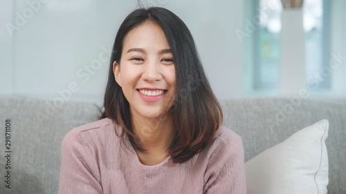 Teenager Asian woman feeling happy smiling and looking to camera while relax in living room at home Canvas Print