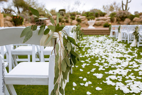 wedding aisle with greenery and white petals Canvas Print