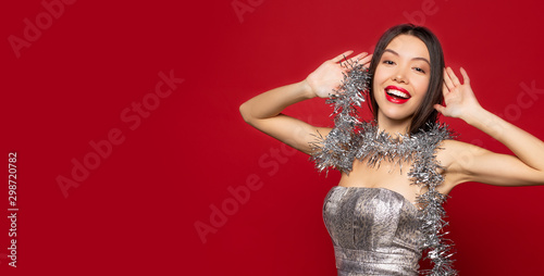 Photographie Attractive smiling dancing girl with red lips in silver dress