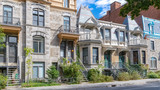 Fototapeta Na drzwi - Montreal, typical victorian house with exterior staircase in the Plateau Mont-Royal district in autumn