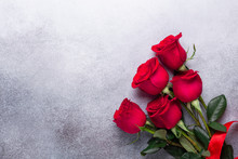 Red Rose Flowers Bouquet On Stone Background Valentine's Day Greeting Card Copy Space