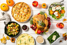 Selection Of Traditional Thanksgiving Food - Turkey, Mashed Patatoes, Green Beans, Apple Pie On Rustic Background, Top View