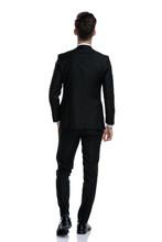 Back View Of Elegant Man In Tuxedo Walking