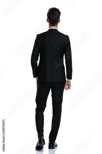 Fototapeta  back view of elegant man in tuxedo walking