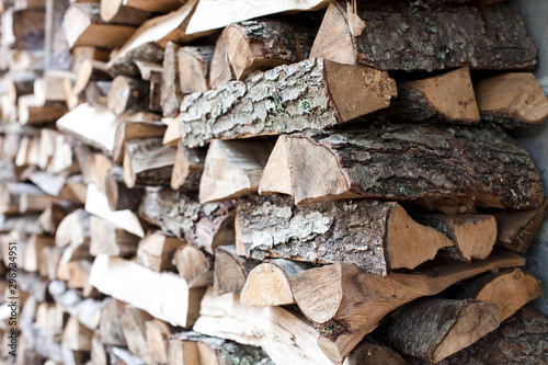 Woodpile of firewood by house Fototapeta