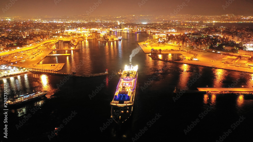 Fototapety, obrazy: Aerial drone night shot of beautiful illuminated port of Piraeus and huge cruise liner departing to Aegean popular destinations, Attica, Greece