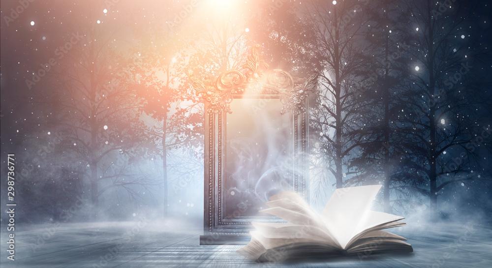 Fototapeta Open book on a dark background, night landscape, dark forest, dark street. Big magic mirror. Smog, smoke, abstract neon light.