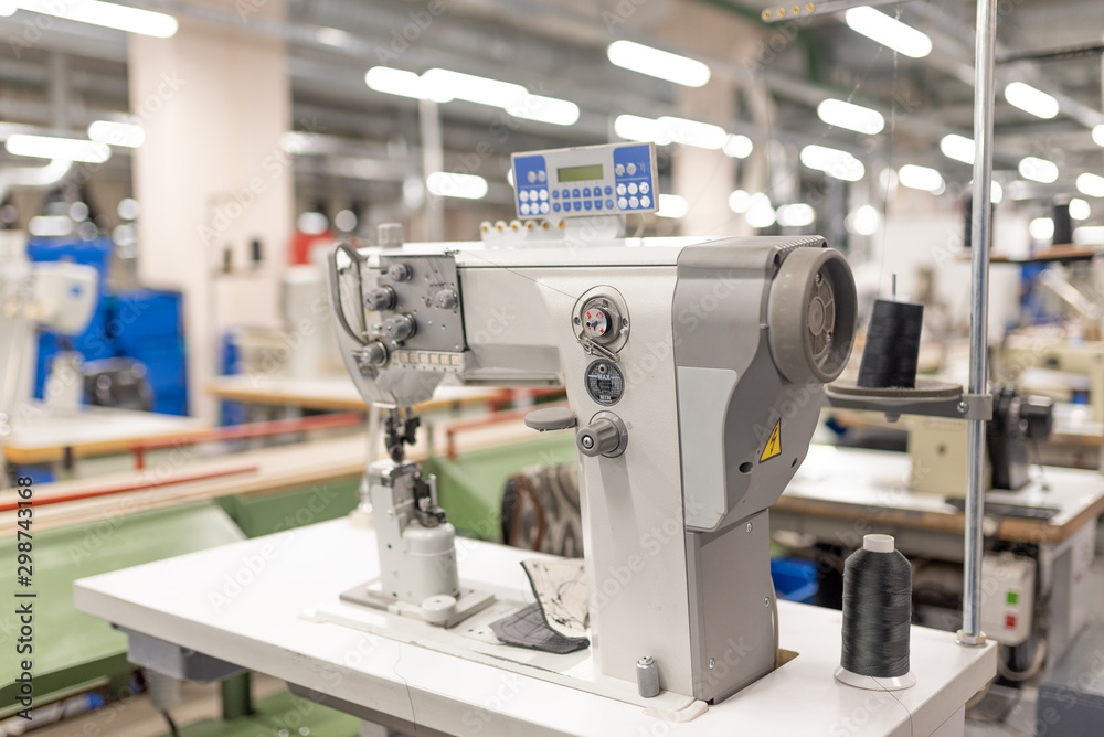 Fototapety, obrazy: Industrial sewing machine in the work shop. Shoe manufacturing.
